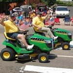Mark and Walt of Sunny.Fm Morning Show on Riding Mowers at the 4th of July Parade in Marquette, Michigan 2013