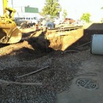 July 24 it is messy on the south side downtown Ishpeming as cosntruction continues