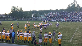 The Negaunee Miners and Gladstone Braves on the Field in Gladstone for Football Night in Negaunee from Gladstone on Sunny.FM