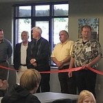 Township Supervisor Dennis Liimatta (right) makes a speech following the Ribbon Cut at the new Marquette Township Community Room