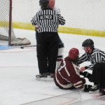 Royales' Nick DeSimone goes down to a Federals fighting penalty