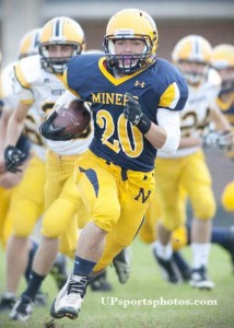 Tyler LaJoie (20) of the Negaunee Mineers runs with the ball for a touchdown during their high school varsity football game against the Iron Mountain Mountaineers in Negaunee, MI on Sept. 20, 2013. (UPsportsphotos.com photo by Ronen Zilberman)