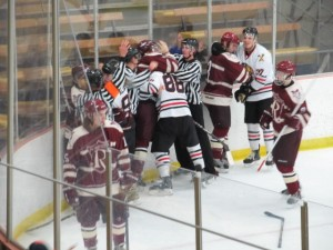 Linesman breaking up a fight