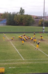 The Negaunee Miners warm-up on the field before their game against the Norway Knights at home in Negaunee on Friday, October 4, 2013.