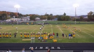 The Negaunee Miners face off against the Norway Knights during their high school varsity football game in Negaunee on Friday, Oct. 4, 2013.