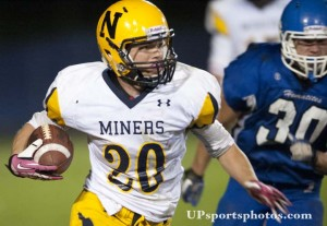 Negaunee Miners' Tyler LaJoie runs with the ball during their high school varstiy football game against next door rivals the Ishpeming Hematites on Friday, Oct. 11, 2013 in Ishpeming, MI. (UPsportsphotos.com image by Ronen Zilberman)