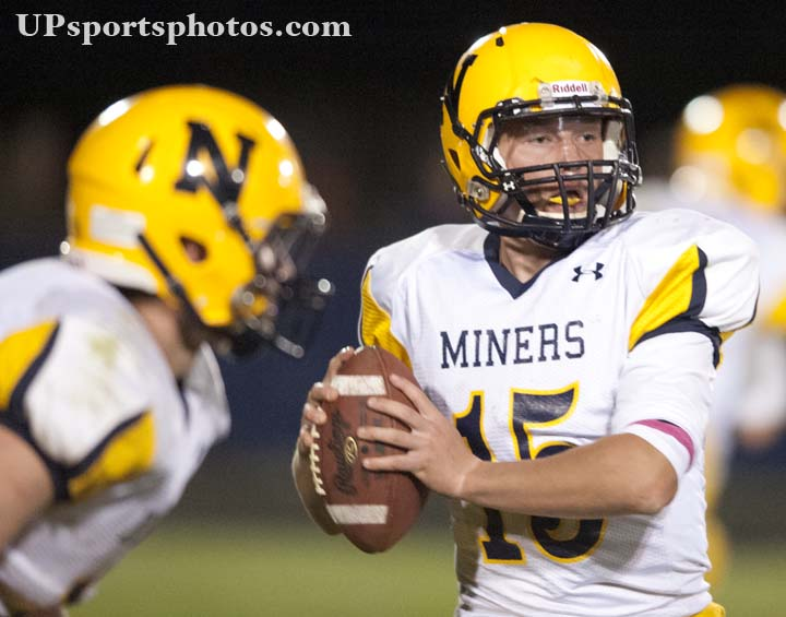 Negaunee Miners' quarterback Ryan Syrjala (15) looks to throw the ball during their high school varstiy football game against next door rivals the Ishpeming Hematites on Friday, Oct. 11, 2013 in Ishpeming, MI. (UPsportsphotos.com image by Ronen Zilberman)