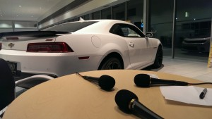 103 FXD ready to broadcast LIVE next to this sports car at Frei Chevy Marquette