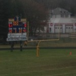 The scoreboard reads the Negaunee Miners WIN 51-0 over the Inland Lakes Bulldogs on Sunny.FM