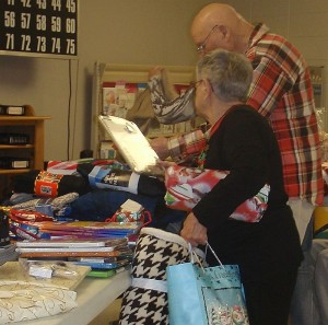The Veterans dig in to all of the items and select presents for themselves.