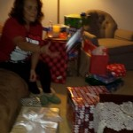 My mom getting all of the presents ready.