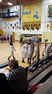 The team gave Courtney Finnila a hug or two after she put in the winning free throws for the Miner girls.