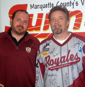 Royales' Asst. Head Coach Cliff Cook and Hoover's Auto Body owner Bob Airaudi.  (Check out the autographed team jersey!)