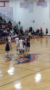 Both teams shake hands before their game on Wednesday in Westwood.