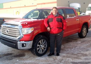 Paul Halbur, GM at Riverside Marquette, with a 2014 Toyota Tundra Limited.