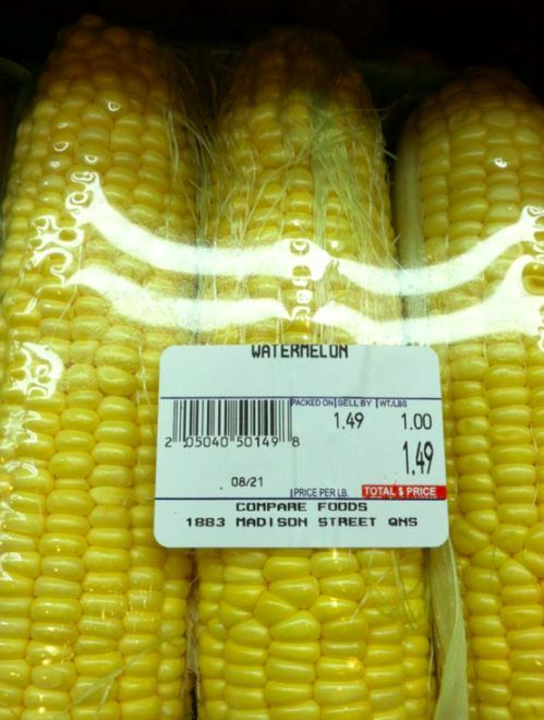 a super price for 3 watermelon - hold it those are ears of corn