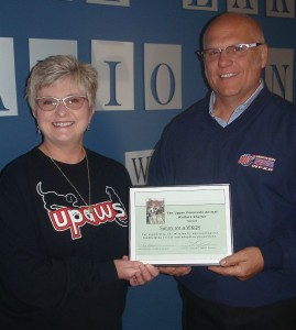 Ann Brownell from UPAWS presents a Certificate of Special Recognition to GLR Owner/GM Todd Noordyk