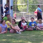 Spectators in the shade at Community Day in Marquette Township.