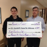 Allen Richards from Kewadin Cares presents Ken Arseneau from the Jacobetti Home a check for $500 towards the Member Assistance Fund