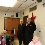 Walt and Mike welcome everyone to the Christmas is for Veterans event at the Jacobetti Home for Veterans
