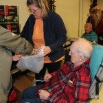 Veterans at the DJ Jacobetti Home for Veterans pick out gifts at the Christmas is for Veterans celebration