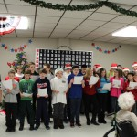 Bothwell middle schoolers sing Christmas carols at the Jacobetti Home for Veterans