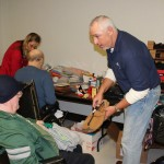 Bill Tibor helps hand out gifts for the Christmas is for Veterans at the DJ Jacobetti Home for Veterans
