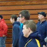 Coach Ed Champion and Kyle Scheiding look on during a meet at Marquette Senior High School on December 20th.