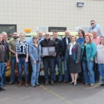 Todd Noordyk holds Sunny FM's award for Station of the Year