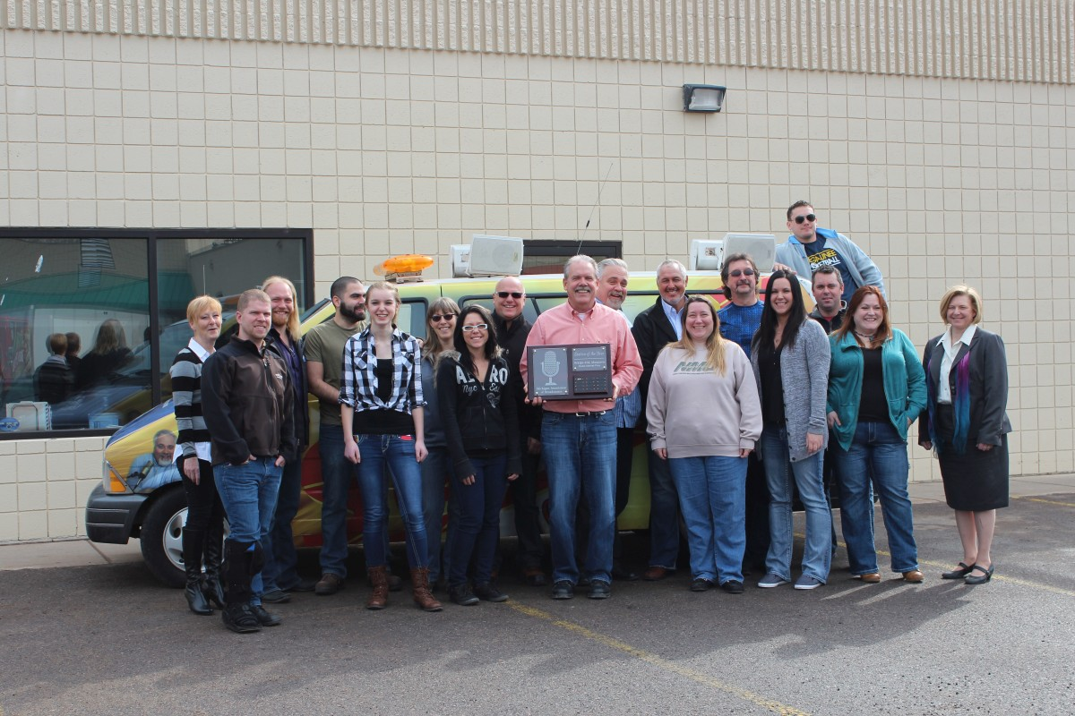 Gordy Mielke holds Sunny FM's award for Station of the Year
