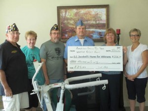 From left: Jim Feliciano, Veterans Affairs Services; Helen Noel, American Legion Auxiliary Post #349; Richard Wood, past commander of the Sons of the American Legion Post #349; Dale Ackerly, commander of Post #349; Tina Lynch, director of nursing; and Sally Searle, volunteer for the Wounded Warrior Relief Fund of Marquette County.