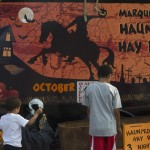 The kids could play a little dress up outside the Haunted Hay ride sign for October 2015 at the Marquette County Fair