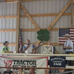 Todd Noordyk speaking at the Win the Meat Giveaway in the Livestock Barn at the Marquette County Fair 2015