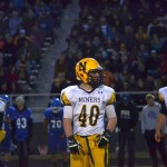 One of Negaunee's Varsity Football Players with the crowd cheering them on!