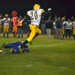 #20 jumping over an ishpeming hematite player to avoid injury