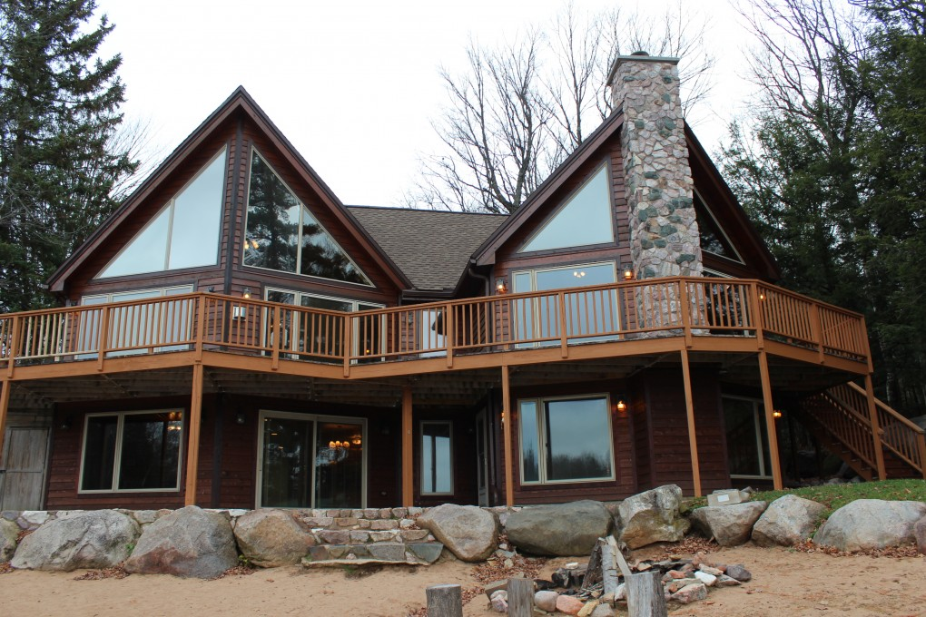 Come see this beautiful executive home on shag lake open Lake house windows