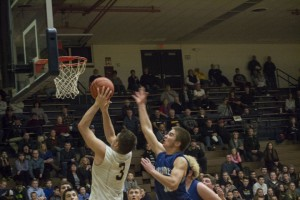 Negaunee Miners Varisty Basketball play takes the shot on the basket!