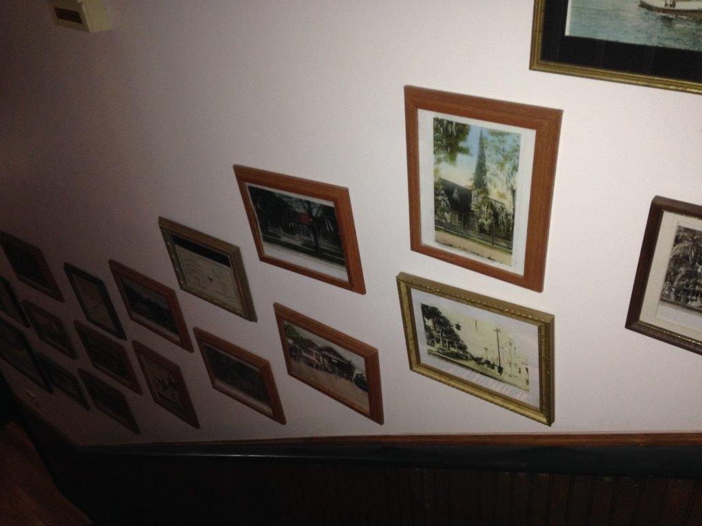 Some of the many frames along History Wall at the River Park Inn