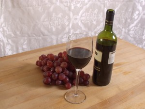grapes glass wine bottle