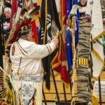 One of the elders blessing the flags.