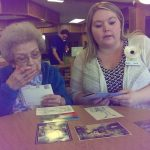 Mill Creek's Sarah DeRoche Memory Care Activities Director working with a resident