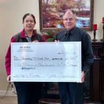 Aurora Cardoso, General Manager at Sol Azteca Mexican Restaurant presenting the $1,300 check to Bred Slagle from the D.J. Jacobetti Home for Veterans