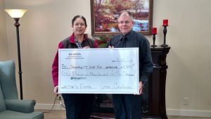 Aurora Cardoso, General Manager at Sol Azteca Mexican Restaurant presenting the $1,300 check to DJ Jacobetti Home for Veterans
