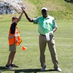 Roy Green high-fives a young course monitor