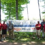 Great Lakes Radio in front of banner