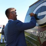 Mason Crosby signs Green Bay Packer Logo on van