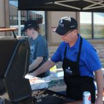 Terry Garceau from Honor Business Services cookin up some dogs