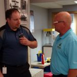 Major Discount talking with the Honor Credit Union staff