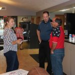 Gwinn Branch Manager Adel Jacobson laughing it up with Scott