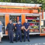 Marquette Charter Township Fire Truck and Team with Township Manager